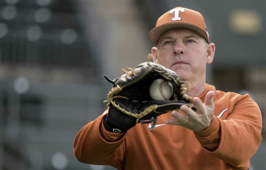 Texas coach David Pierce warms up during the first practice of the season at UFCU Disch-Falk Field in Austin on Jan. 27, 2017. Photo: Richard B. Brazziell /Austin American-Statesman