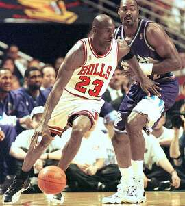 Michael Jordan takes on Utah's Karl Malone in the 1997 Finals.