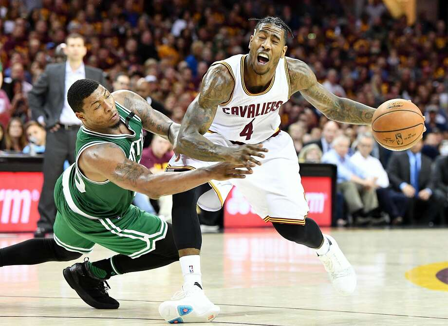 Marcus Smart of the Boston Celtics fouls Iman Shumpert #4 of the Cleveland Cavaliers in the second half during Game Three of the 2017 NBA Eastern Conference Finals at Quicken Loans Arena on May 21, 2017 in Cleveland, Ohio.  Photo: Jason Miller, Getty Images