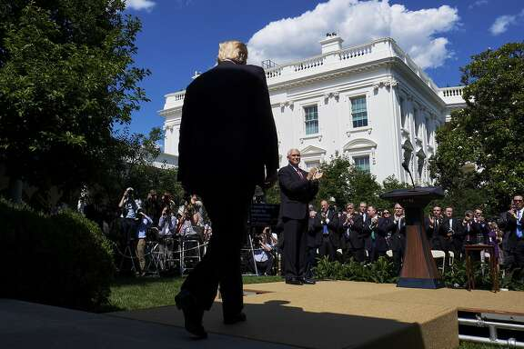 U.S. President Donald Trump walks to the podium before making an announcement in the Rose Garden of the White House in Washington, D.C., U.S., on Thursday, June 1, 2017. Trump announced the U.S. would withdraw from the Paris climate pact and that he will seek to renegotiate the international agreement in a way that treats American workers better. Photographer: T.J. Kirkpatrick/Bloomberg