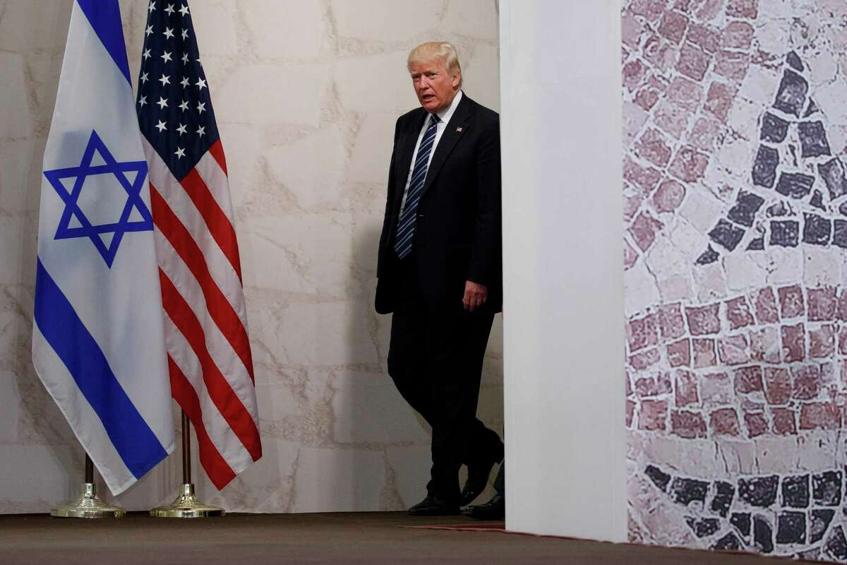 FILE - In this May 23, 2017 file photo, President Donald Trump arrives to speak at the Israel Museum in Jerusalem. A senior Israeli official is expressing disappointment over TrumpÂ?'s decision against relocating the embassy to Jerusalem and is accusing the U.S. of caving in to Arab pressure. (AP Photo/Evan Vucci, File)