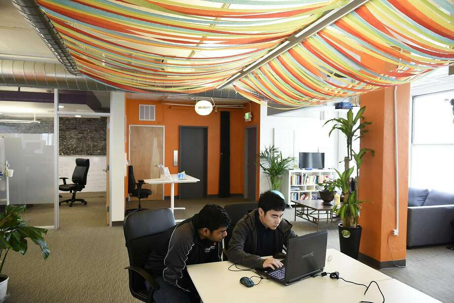Technical consultant Raj Kumar (left) and software engineer Wang Kai work together at Civil Maps' offices. Photo: Michael Short, Special To The Chronicle