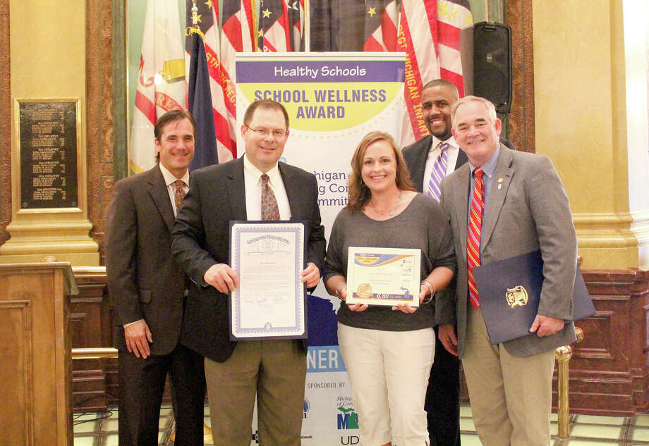 Laker Secondary Schools recently received the Michigan School Wellness Gold Award for its ongoing comprehensive efforts to ensure students' health and wellness so they can be strong learners. Laker Secondary School Principal Jon Good (pictured second from the left) and Scheurer School Clinic nurse Susie Irion (third from the left) attended an award ceremony in Lansing. They're joined by Nick Lyon, Michigan Department of Health and Human Services director (pictured far left), Kyle Guerrant, Michigan Department of Education deputy superintendent of finance and operations (pictured second from the right) and State Rep. Dr. Ned Canfield (pictured far right). Photo: Submitted Photo