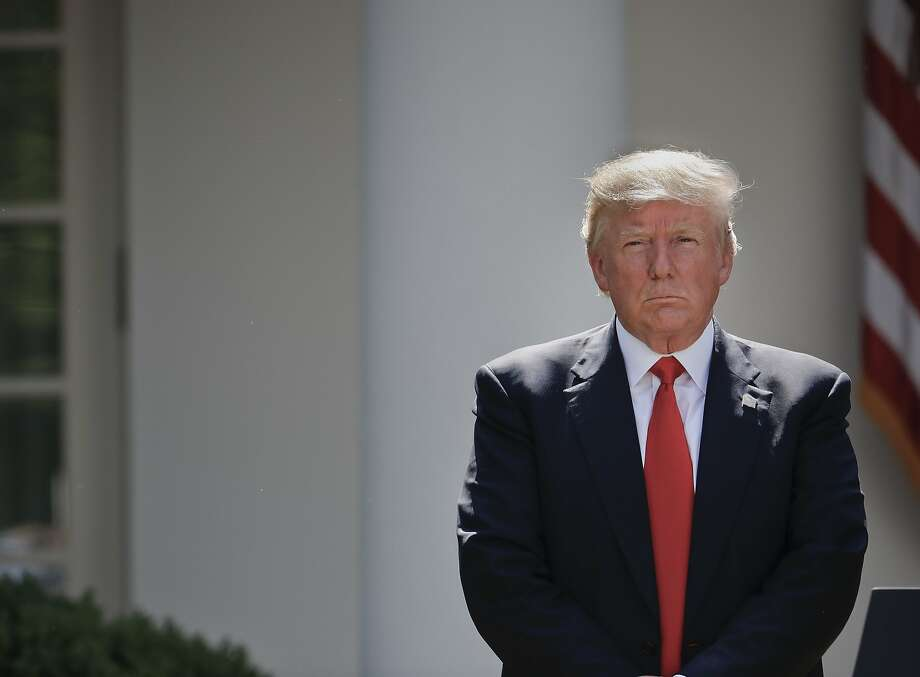 President Donald Trump stands next to the podium after speaking about the U.S. role in the Paris climate change accord, Thursday, June 1, 2017, in the Rose Garden of the White House in Washington. (AP Photo/Pablo Martinez Monsivais) Photo: Pablo Martinez Monsivais, Associated Press