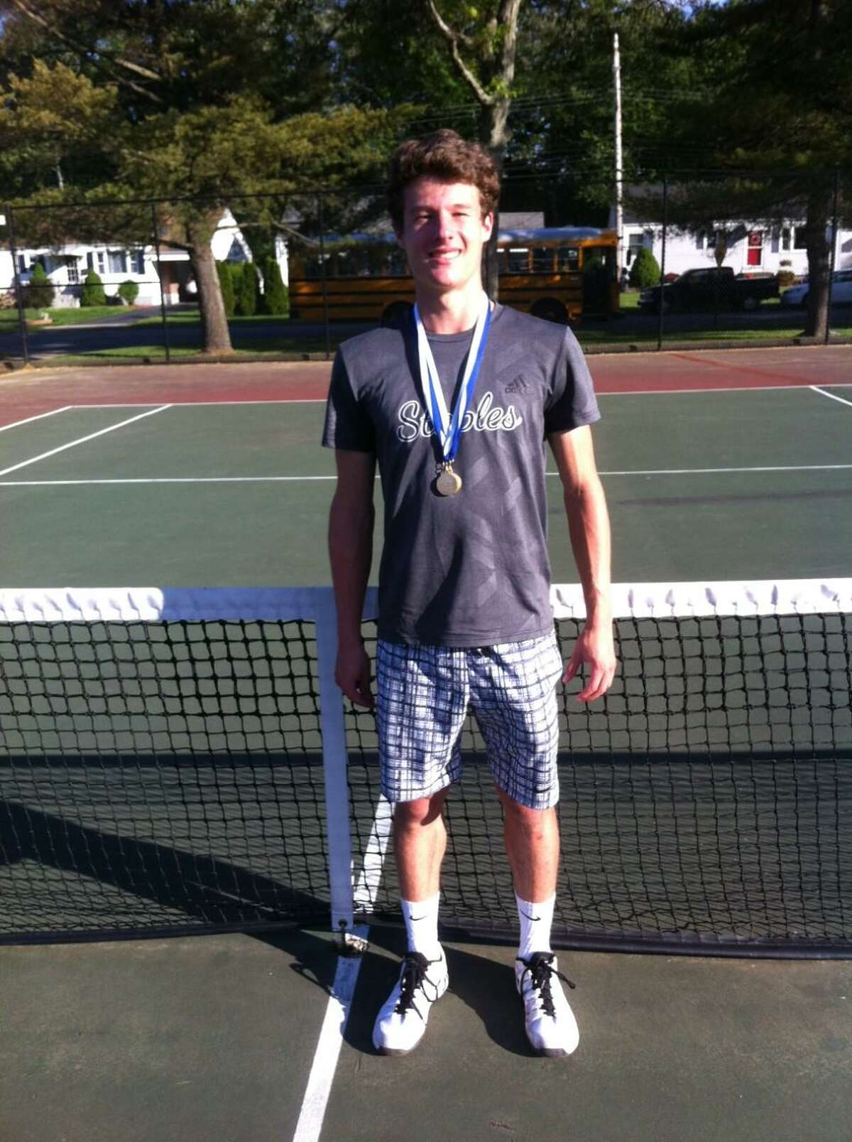 Evan Felcher of Staples won the Class LL tournament singles championship Thursday by defeating Greenwich's Eric Toub in the finals.