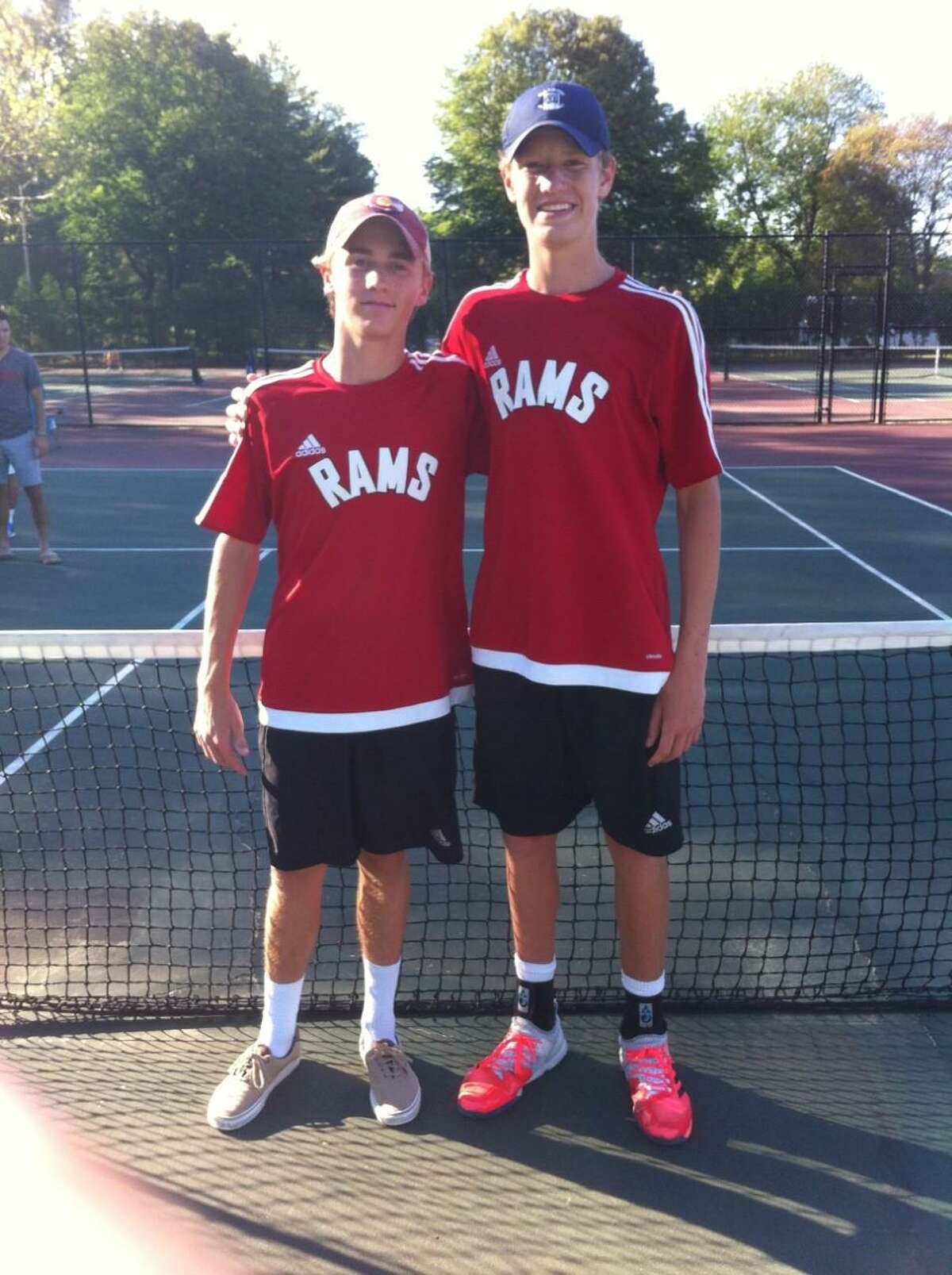 Luke Crowley, left, and Matthew Brand of New Canaan won the Class L tournament doubles championship on Thursday at Conard High School in West Hartford. They defeated teammates Chris Greene and Jack O'Connor in the finals.