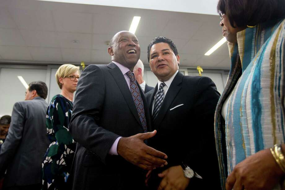 Houston Mayor Sylvester Turner talks with HISD Superintendent Richard Carranza during the grand opening celebration for the new Michael E. DeBakey High School for Health Professionals in the Texas Medical Center, Thursday, June 1, 2017, in Houston. Photo: Mark Mulligan, Mark Mulligan / Houston Chronicle / 2017 Mark Mulligan / Houston Chronicle