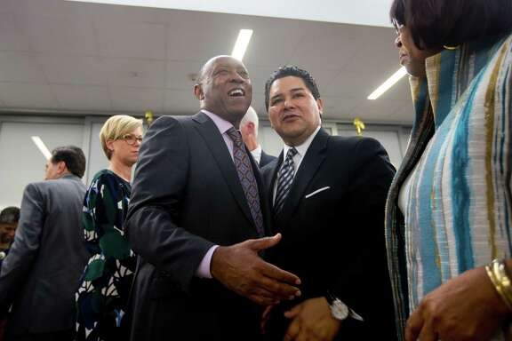 Houston mayor Sylvester Turner talks with HISD superintendent Richard Carranza during the grand opening celebration for the new Michael E. DeBakey High School for Health Professionals in the Texas Medical Center, Thursday, June 1, 2017, in Houston.