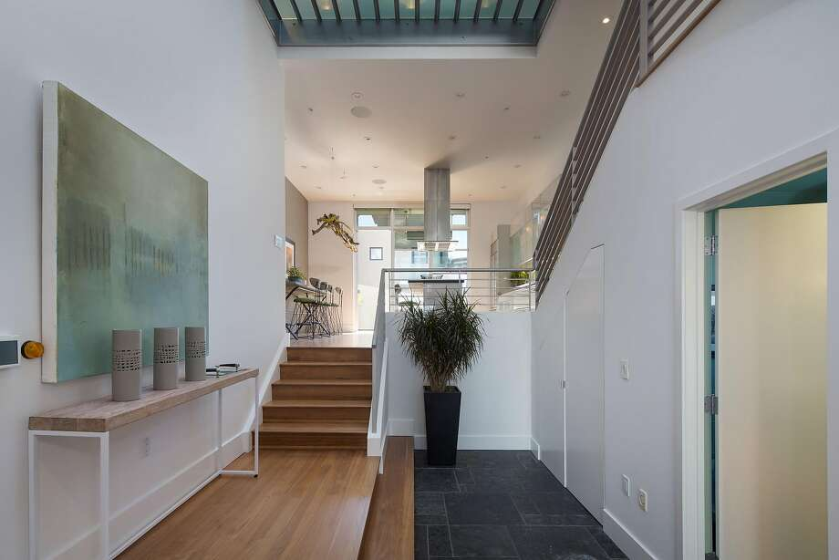 The foyer rests beneath skylights and offers a staircase ascending to the main level. Photo: Olga Soboleva / Vanguard Properties