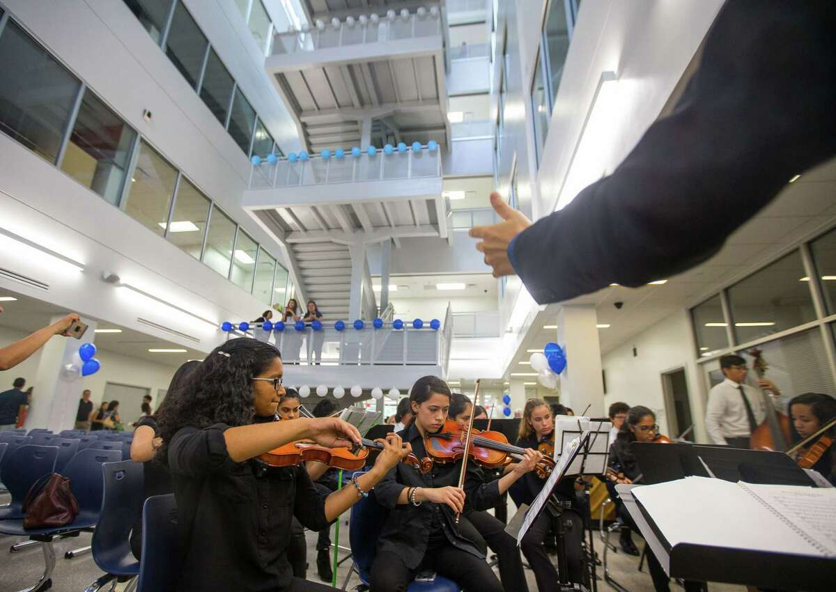 Members of the DeBakey HSHP Orchestra play music during the grand opening celebration for the new Michael E. DeBakey High School for Health Professionals in the Texas Medical Center, Thursday, June 1, 2017, in Houston. (Mark Mulligan / Houston Chronicle)