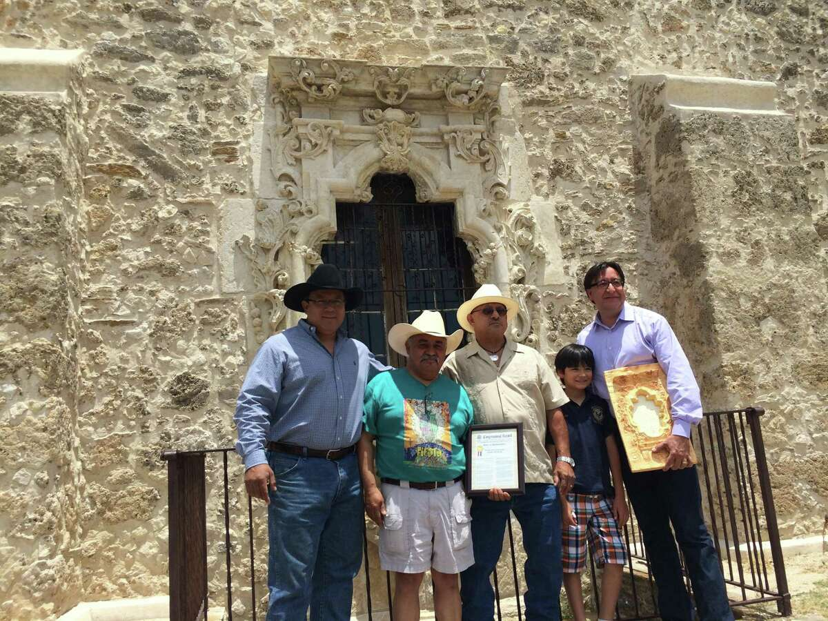 U.S. Rep. Pete Gallego (right) is shown in a 2014 photo with descendants of Pedro Huízar after reading into the Congressional Record the history of the man believed to have created the famed Rose Window at Mission San José. Shown (left to right) are Edward Huízar; Jerry Huízar; Vincent M. Huízar; Nicholás Miguel Ramon Gallego, the congressman's son; and the congressman.