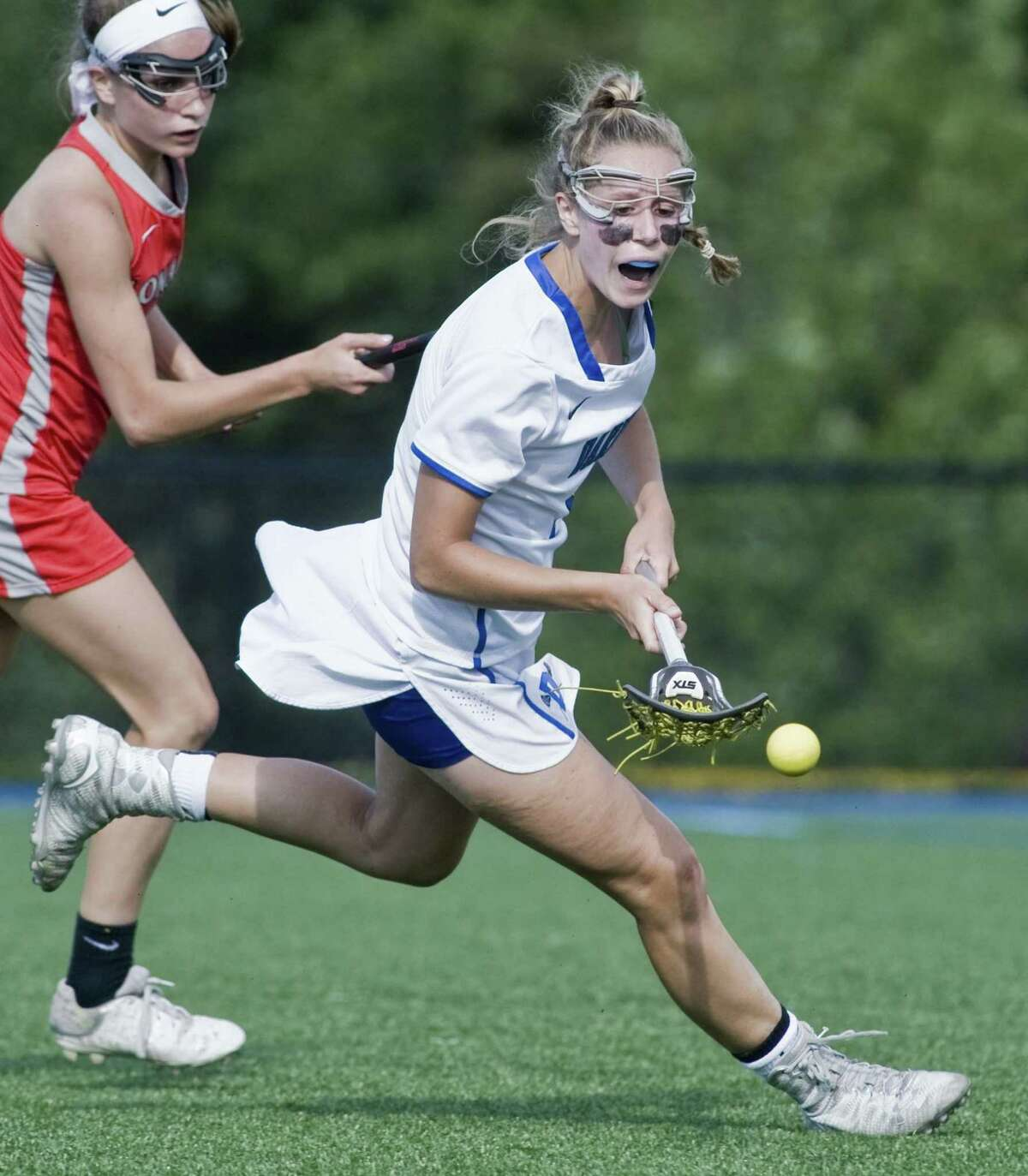 Darien High School's Emma Jaques chases a loose ball in the Class L girls lacrosse game against Conard High School, played at Darien. Thursday, June 1, 2017