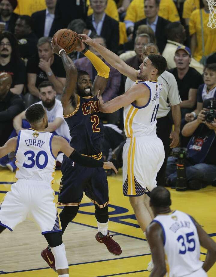 Golden State Warriors' Klay Thompson defends against Cleveland Cavaliers' Kyrie Irving in the first quarter during Game 1 of the 2017 NBA Finals at Oracle Arena on Thursday, June 1, 2017 in Oakland, Calif. Photo: Carlos Avila Gonzalez, The Chronicle