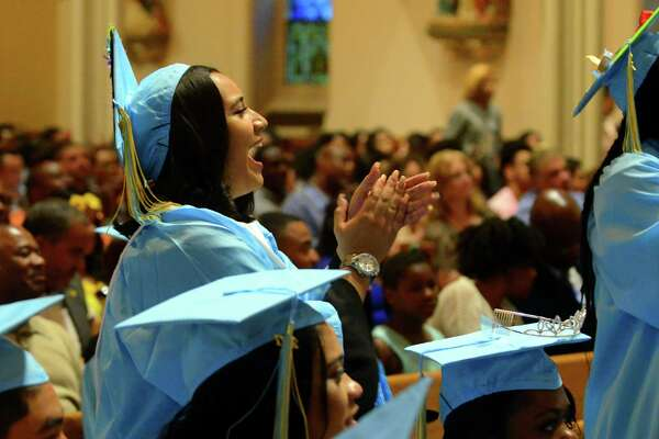 Cynthia Moyano cheers for a fellow graduate during Kolbe Cathedral's Class of 2017 Commencement Exercises at St. Augustine Cathedral in Bridgeport, Conn., on Thursday June 1, 2017.