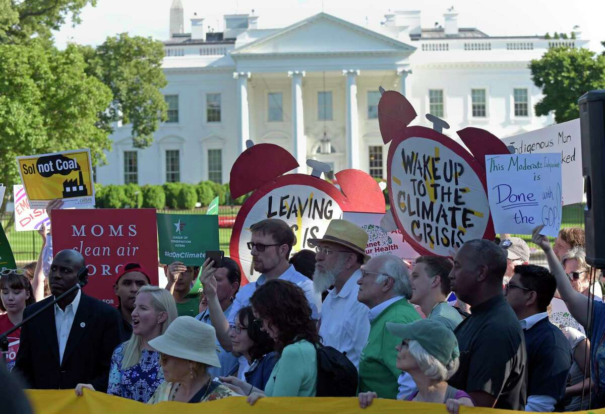 Protesters gather near the White House after President Donald Trump announced his climate decision.