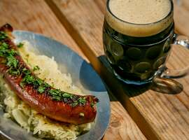 The smoked Kielbasa Sausage with a beer at Joinery in Sausalito, Calif., is seen on June 1st, 2017.