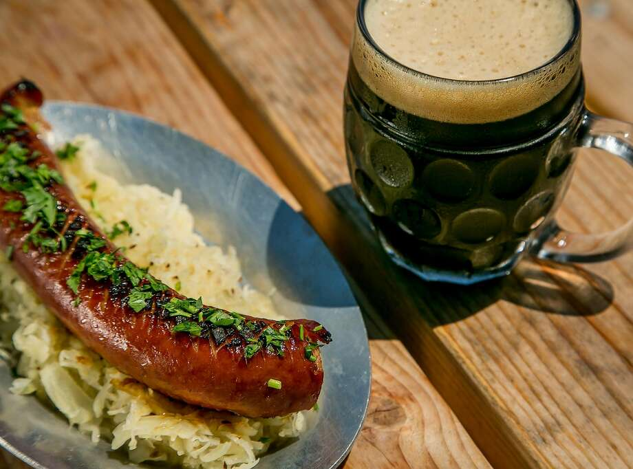 Smoked kielbasa Sausage with a beer at Joinery. Photo: John Storey, Special To The Chronicle