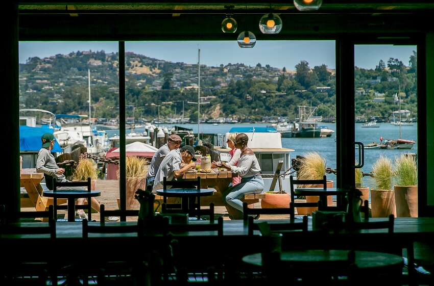 People have lunch on the deck at Joinery in Sausalito, Calif., on June 1st, 2017.