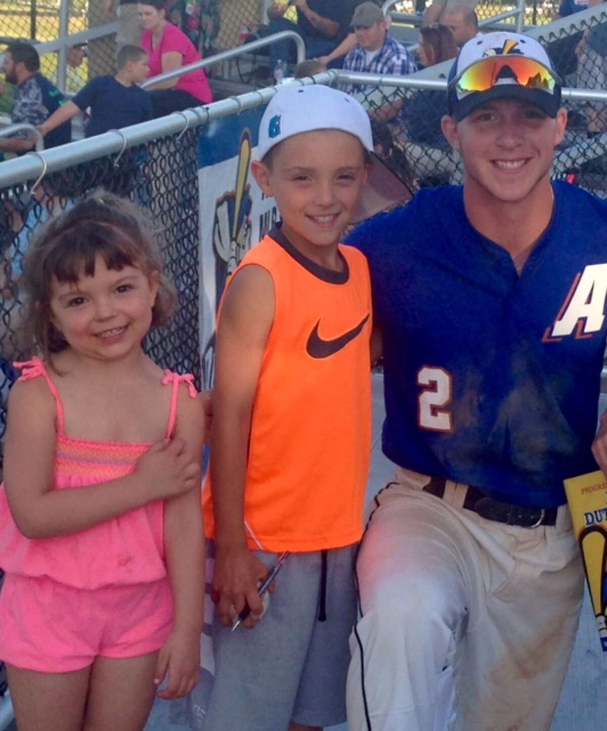 Albany Dutchmen player Justin Childers poses with Ryan Scholz, center, and Ava Scholz, part of the host family that houses Childers during the season. (Courtesy of Scholz family)