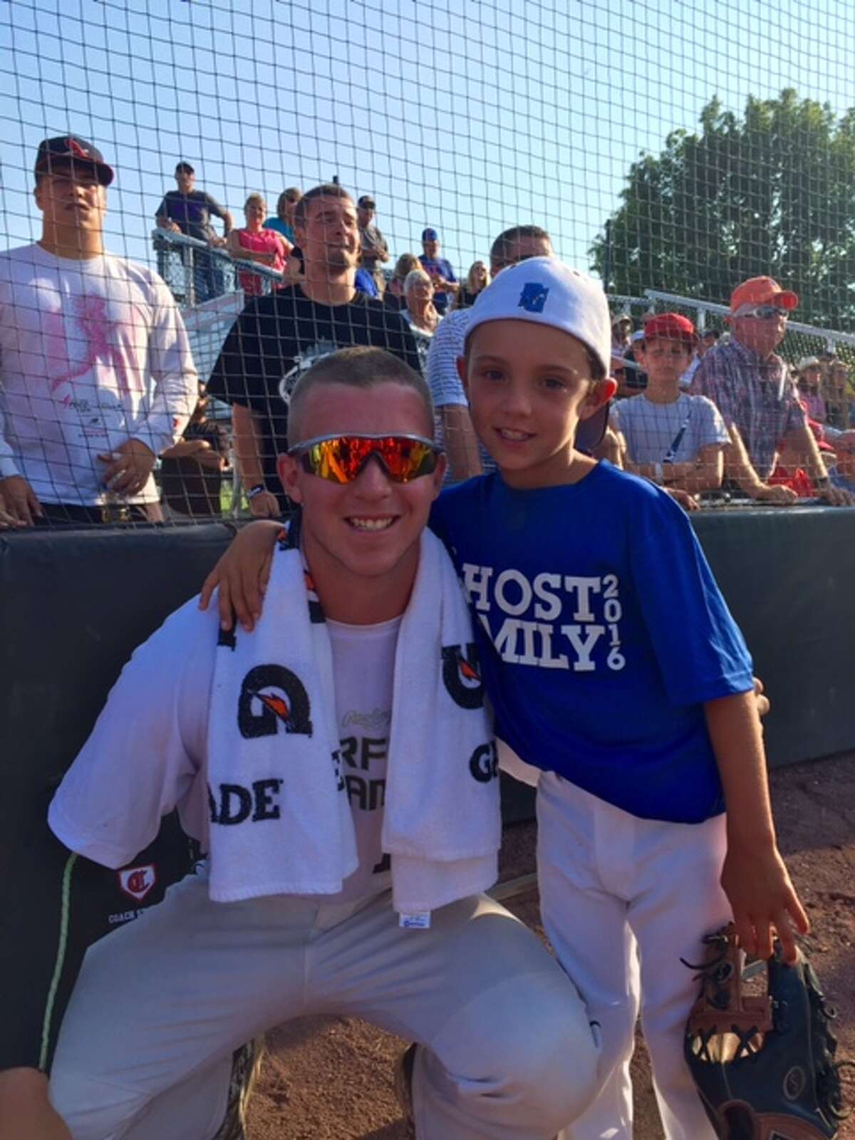 Albany Dutchmen player Justin Childers poses with Ryan Scholz, part of the host family that houses Childers during the season. (Courtesy of Scholz family)
