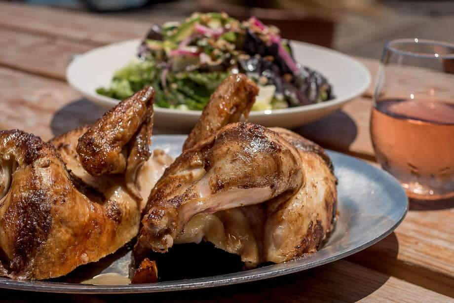 Rotisserie chicken, Little Gem salad and a glass of rose at Joinery. Photo: John Storey, Special To The Chronicle