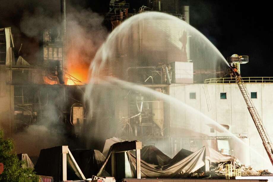 Firefighters tend to the blaze Thursday after a fatal explosion at the Didion Milling plant in Cambria, Wis., which injured about a dozen people. Photo: Jeff Lange, HONS / Jeff Lange