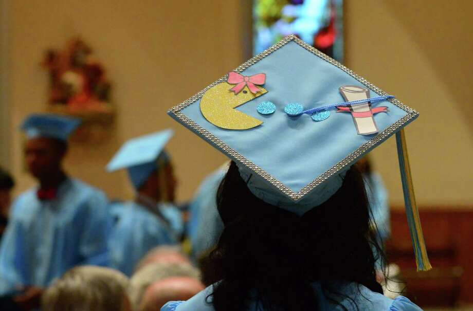 Click through the slideshow to view some of the best college graduation caps we spotted this year. Photo: Christian Abraham, Hearst Connecticut Media / Connecticut Post