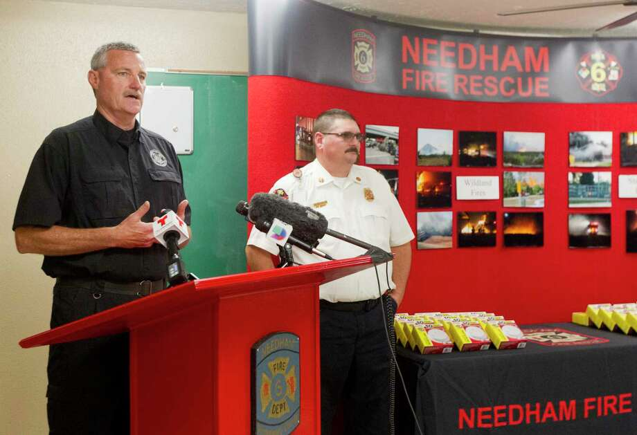 Montgomery County Fire Marshal Jimmy Williams speaks alongside Needham Fire Department Chief Kevin Hosler during a press conference at the Needham Fire Station, Thursday.  Williams announced a new safety initiative to install smoke detectors in home for Tamina community, east of The Woodlands, at an event later to be determined.  The initiative stems from a two-story house fire on May 12 in Tamina that killed three children and injured five others. Photo: Jason Fochtman, Staff Photographer / © 2017 Houston Chronicle