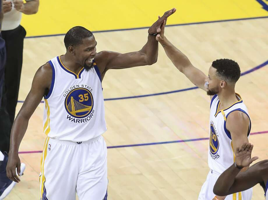 Golden State Warriors' Kevin Durant and Stephen Curry high five in the second quarter during Game 1 of the 2017 NBA Finals at Oracle Arena on Thursday, June 1, 2017 in Oakland, Calif. Photo: Scott Strazzante, The Chronicle