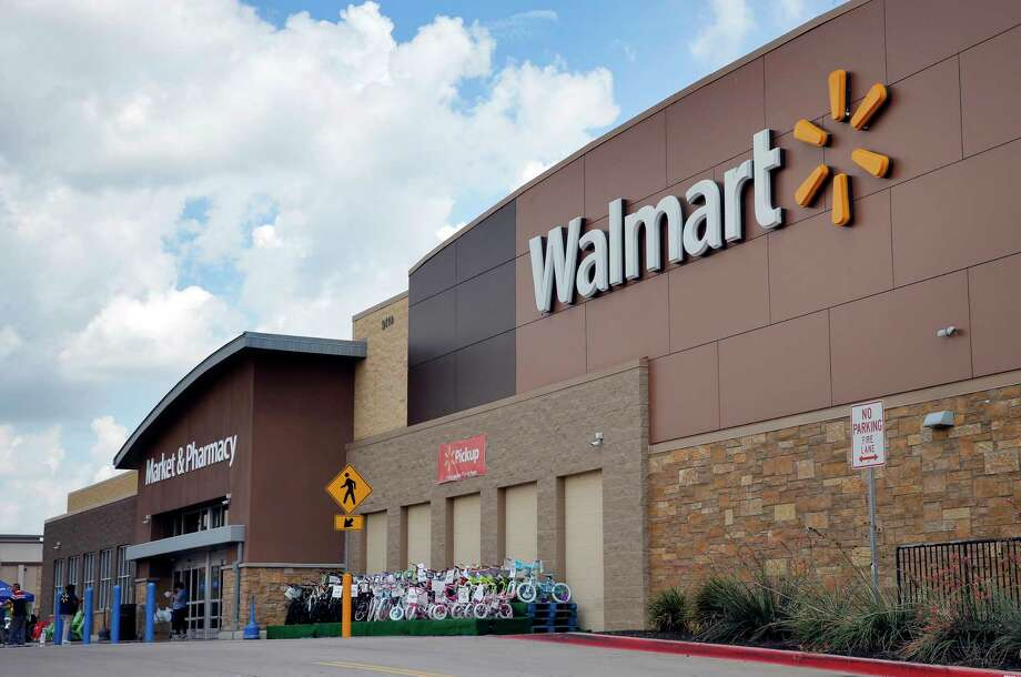 FILE - In an  Aug. 26, 2016 file photo, people walk in and out of a Walmart store, in Dallas. Walmart is testing a delivery service using its own store employees, who will deliver packages ordered online while driving home from their regular work shifts. The world's largest retailer says workers can choose to participate and would be paid. The service is being tested at two stores in New Jersey and one in Arkansas.  (AP Photo/Tony Gutierrez, File) Photo: Tony Gutierrez, STF / Copyright 2017 The Associated Press. All rights reserved.