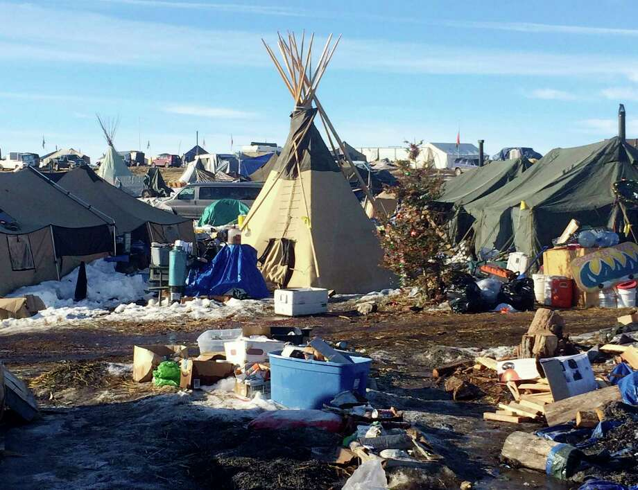 In this Thursday, Feb. 16, 2017, photo, debris is piled on the ground awaiting pickup by cleanup crews at the Dakota Access oil pipeline protest camp in southern North Dakota near Cannon Ball. The camp is on federal land, and authorities have told occupants to leave by Wednesday, Feb. 22 in advance of spring flooding. (AP Photo/Blake Nicholson) Photo: Blake Nicholson, STF / Copyright 2017 The Associated Press. All rights reserved.