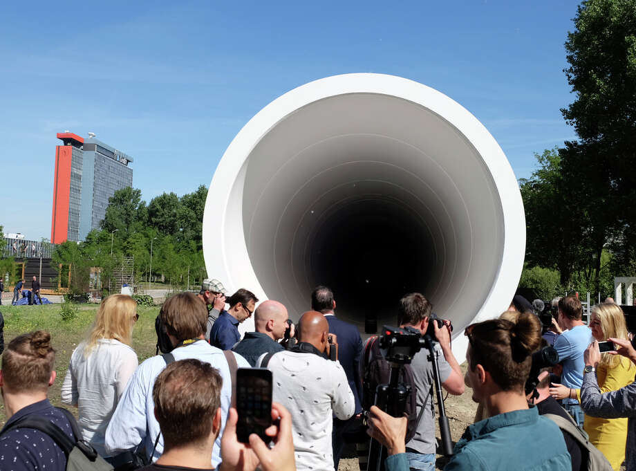 A crowd gathers at the Hyperloop test facility unveiled Thursday by a tech startup and a construction company at Delft Technical University in the Netherlands. The tube, 100 feet long and 10.5 feet in diameter, will be used for low-speed testing in a vacuum. Photo: Mike Corder, STF / AP 2017