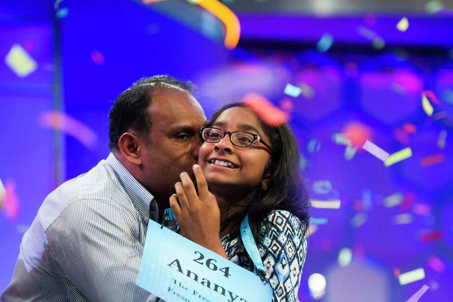 Ananya Vinay, 12, from Fresno, Calif., is kissed by her father Anupanna Vinay moments after winning the 90th Scripps National Spelling Bee in Oxon Hill, Md., Thursday, June 1, 2017. Photo: Cliff Owen, AP / FR170079 AP