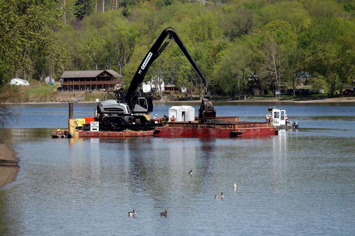 Crews perform dredging work along the upper Hudson River on Thursday, May 7, 2015, in Waterford, N.Y. It is General Electric's sixth and final season for cleaning up PCBs discharged into the river decades ago when they were used as coolants in electrical equipment. (AP Photo/Mike Groll) ORG XMIT: NYMG108