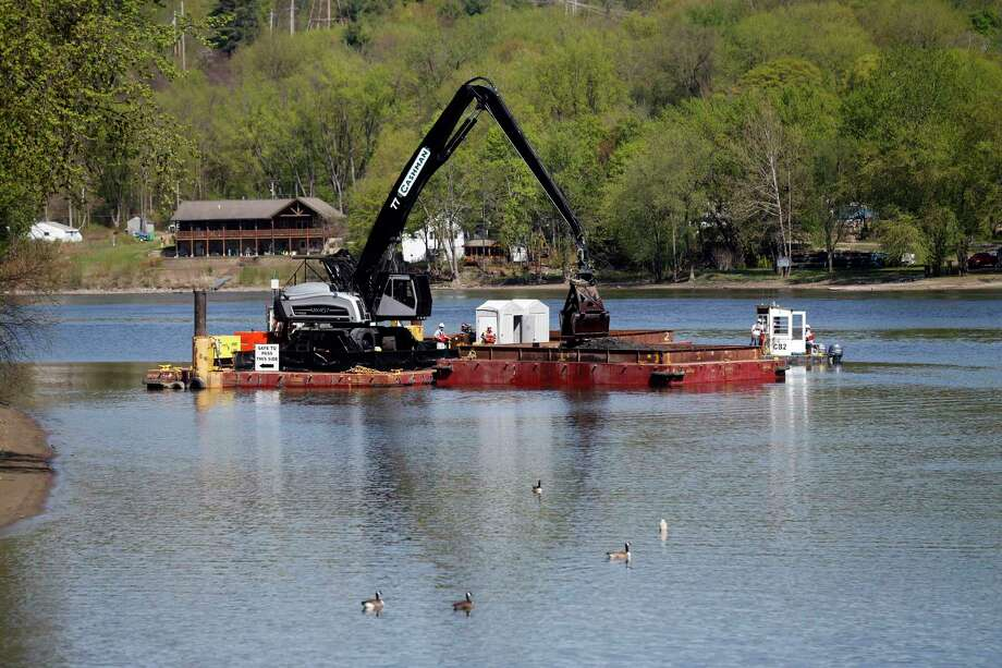 Crews perform dredging work along the upper Hudson River on Thursday, May 7, 2015, in Waterford, N.Y. It is General Electric's  sixth and final season for cleaning up PCBs  discharged into the river decades ago when they were used as coolants in electrical equipment. (AP Photo/Mike Groll)  ORG XMIT: NYMG108 Photo: Mike Groll / AP