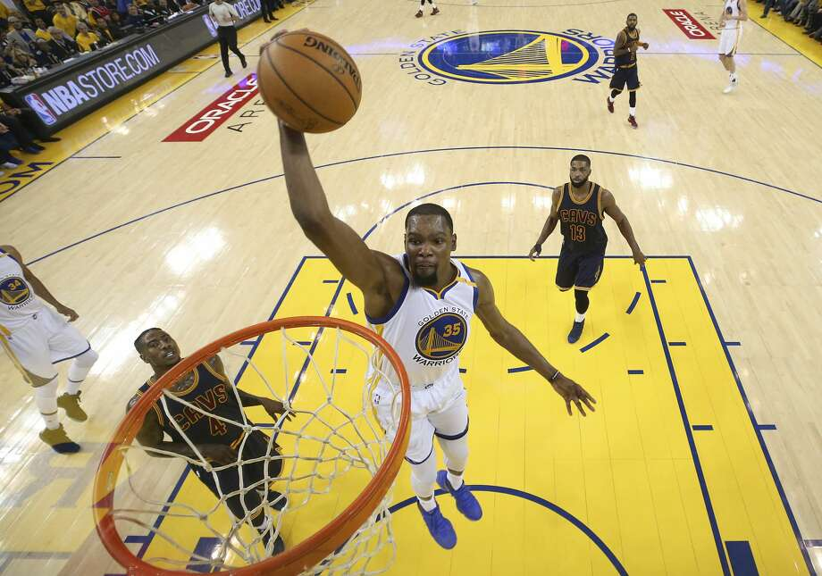 Golden State Warriors forward Kevin Durant (35) dunks against the Cleveland Cavaliers during the first half of Game 1 of basketball's NBA Finals in Oakland, Calif., Thursday, June 1, 2017. (Ezra Shaw/Pool Photo via AP) Photo: Ezra Shaw/Associated Press