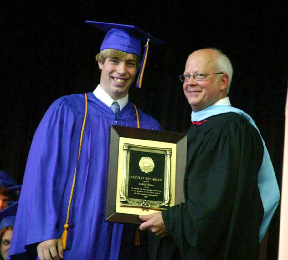 Christian Heritage School Valedictorian Joshua Brake receives the Faculty Key Award from Upper School Principal Bruce Stempien.  The Faculty Key Award, the most prestigious of the senior awards, is given in recognition of the student, who in his years at CHS, made the most unique contribution to the academic and spiritual growth of the school and has successfully used these opportunities for his maximum personal development. Photo: Contributed Photo / CT POST