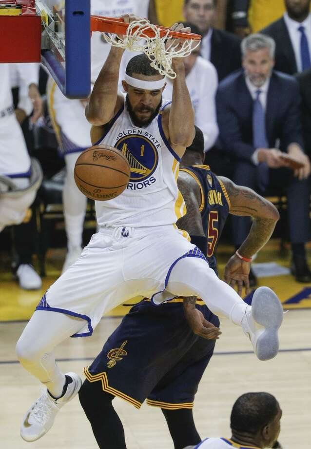 Golden State Warriors' JaVale McGee dunks during his brief but productive stint of playing time in the first quarter. Photo: Carlos Avila Gonzalez / The Chronicle / online_yes