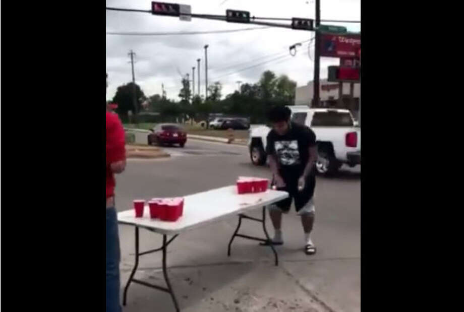 Some local pranksters are facing some controversy after a video was posted to social media showing a couple of young men playing beer pong in the middle of an intersection.Photo: Sol Uresti Facebook Photo: Facebook