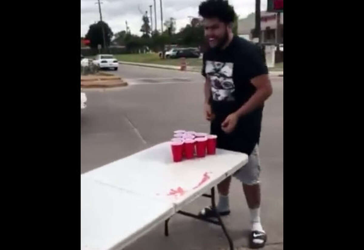 Some local pranksters are facing some controversy after a video was posted to social media showing a couple of young men playing beer pong in the middle of an intersection. Photo: Sol Uresti Facebook