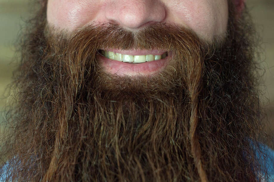 BRITTNEY LOHMILLER | blohmiller@mdn.net Scott Pawlak of Midland poses for a portrait at his home Friday morning. Pawlak won the overall best beard during the second Battle of the Beards on May 11 at Albert's General Store in Bay City. 'It's a lot warmer in the winter,' Pawlak said.