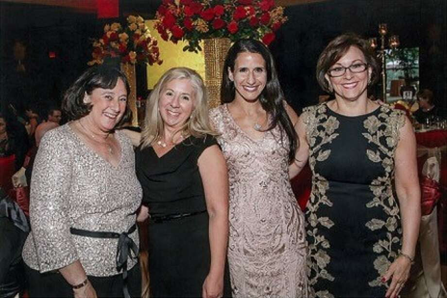 Among the Martha Turner Sotheby's International Realty team supporting the Interfaith Ministries for Greater Houston Gala were: (left to right) Terry Cominsky, Terri Lemons, Leann Salmons and Karen Harberg.