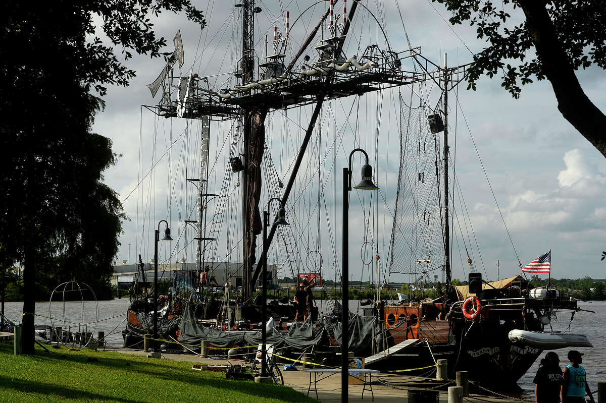 """Workers setup for the Caravan Stage Company's """"Nomadic Tempest"""" show aboard the 90-foot-tall Amara Zee at Riverfront Park on Thursday. The traveling aerial show tells the story of monarch butterflies migrating due to climate change. Shows will be performed at 9 p.m. today and Saturday, and suggested donations are $25 for adults, $15 for students and $10 for kids. Photo taken Thursday 6/1/17 Ryan Pelham/The Enterprise"""