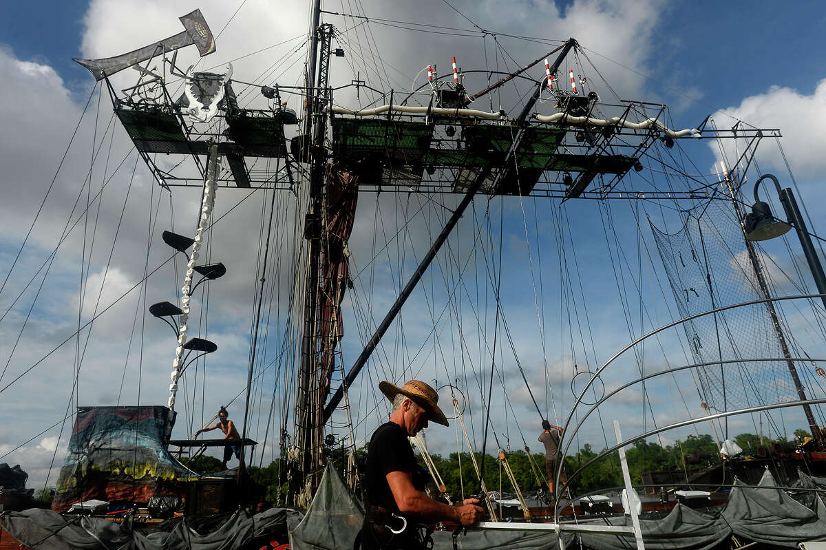 """John Popkins sets up for the Caravan Stage Company's """"Nomadic Tempest"""" show aboard the 90-foot-tall Amara Zee at Riverfront Park on Thursday. The traveling aerial show tells the story of monarch butterflies migrating due to climate change. Shows will be performed at 9 p.m. today and Saturday, and suggested donations are $25 for adults, $15 for students and $10 for kids. Photo taken Thursday 6/1/17 Ryan Pelham/The Enterprise"""