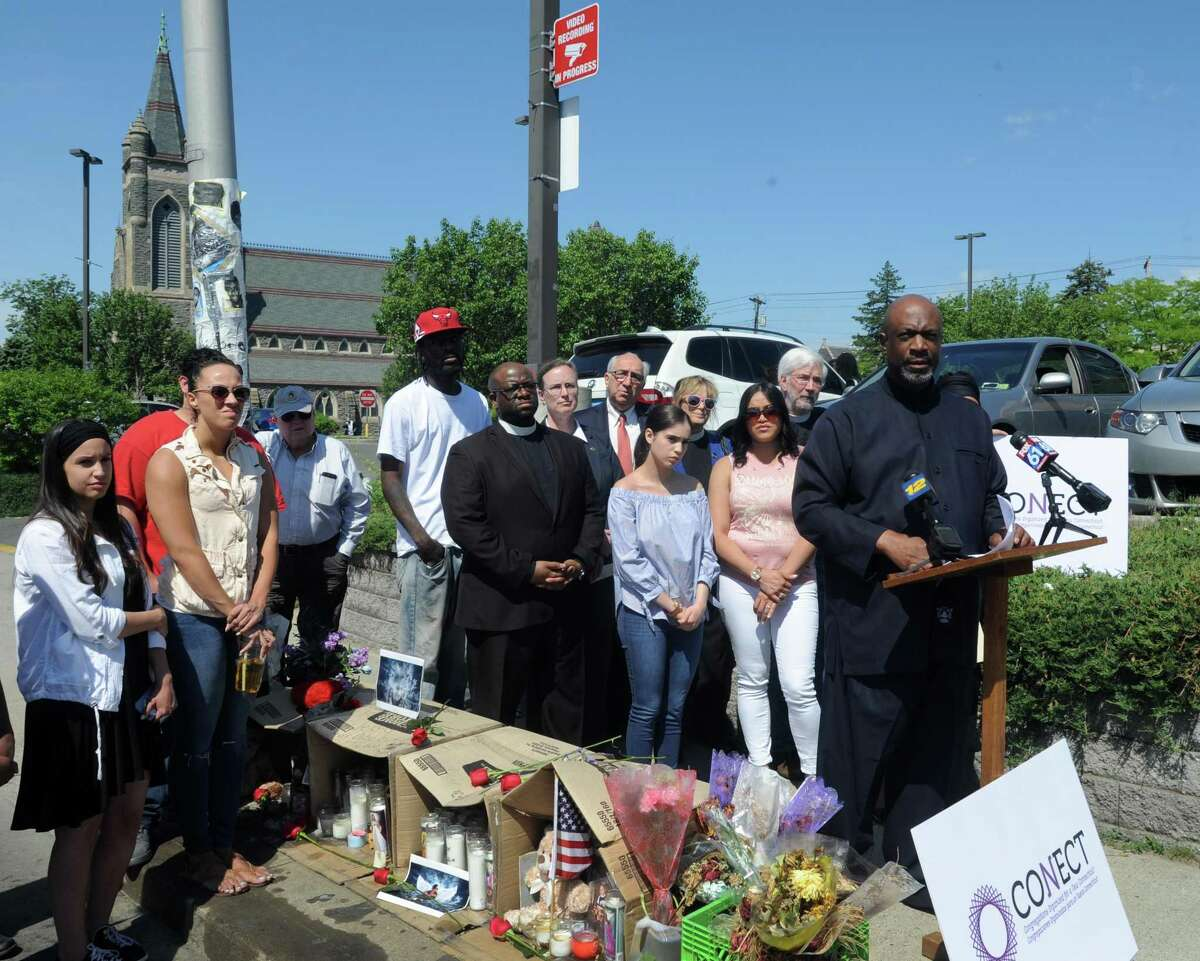 Pastor Anthony Bennett of Mount Aery Baptist Church and other CONECT clergy and lay leaders gathered at the site of Jayson Negron's shooting on Fairfield Avenue in Bridgeport, Conn. With Negron's half-sister Jazmarie Melendez and aunt Grvon Torres, the group called for a more public investigation during a press conference on Friday, June 2, 2017.