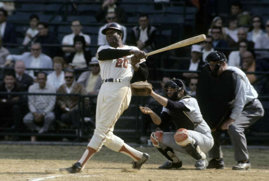 BALTIMORE, MD - CIRCA 1960s: Outfielder Frank Robinson #20 of the Baltimore Orioles swings and watches the flight of his ball during a circa late 1960s Major League Baseball game at Memorial Stadium in Baltimore, Maryland. Robinson played for the Orioles from 1966-71. (Photo by Focus on Sport/Getty Images) Photo: Focus On Sport/Getty Images
