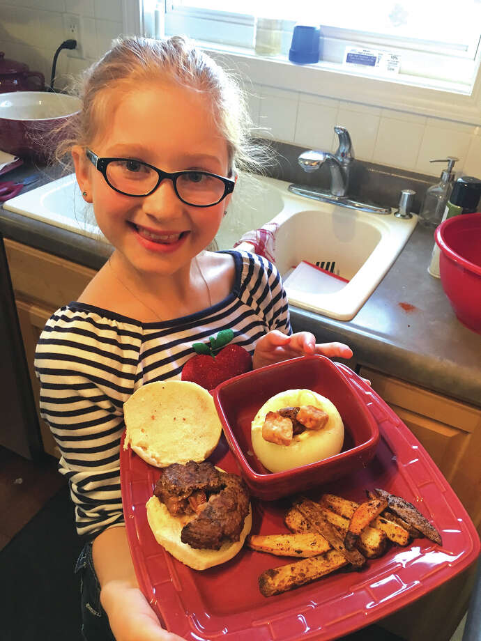 Ella Sedabres in her kitchen with some of her creations. She willl appear on the Food Network's Kids BBQ Championship Monday night. Photo: For The Intelligencer
