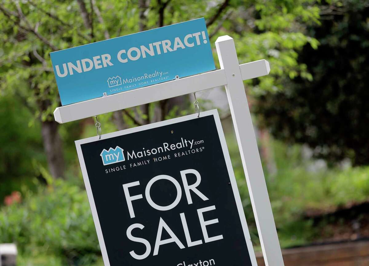 A new lawsuit with the potential to change how homes are bought and sold has caused the Department of Justice to step in, saying it has never ruled that the way real estate agent fees are structured meets antitrust law. The department has opened its own investigation separate from the suit. (AP Photo/Chuck Burton)