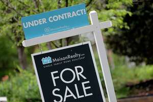 "In this Thursday, April 27, 2017, photo, an ""Under Contract"" sign is posted in front of a home for sale in Charlotte, N.C. On Wednesday, May 31, 2017, the National Association of Realtors releases its April report on pending home sales, which are seen as a barometer of future purchases. (AP Photo/Chuck Burton)"