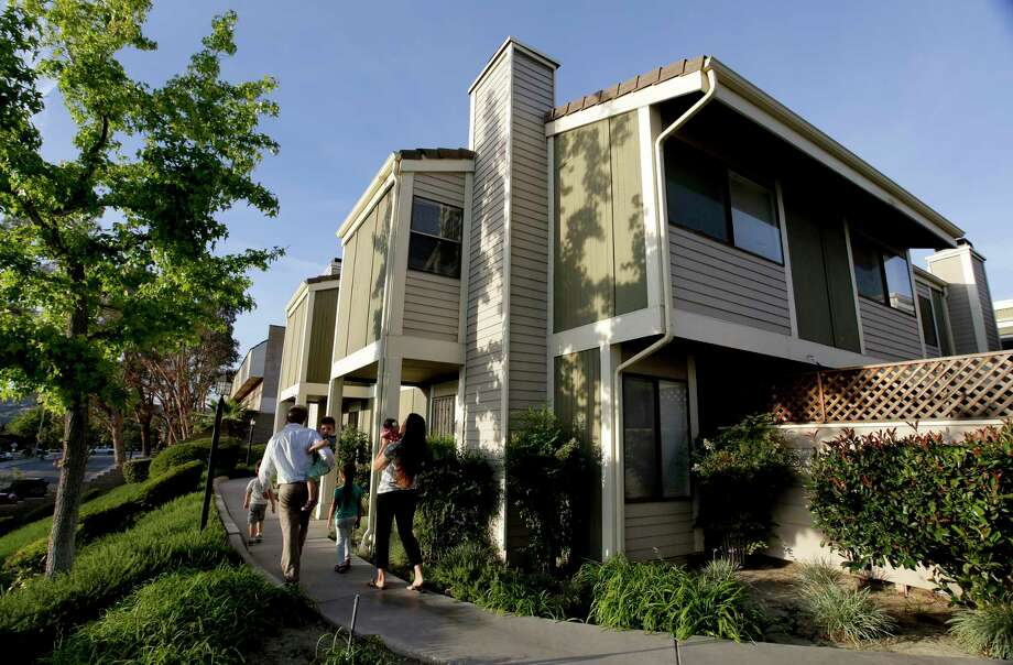 First-time homebuyer Brett Singley, his wife, Angelynn, and their children head to their condo in Santa Clarita, Calif. Consumers signed fewer home sales contracts again in April. Photo: Chris Carlson, STF / Copyright 2017 The Associated Press. All rights reserved.